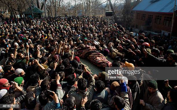 Kashmiris carry the body of a militant during the funeral procession of one of the five militants killed in a gun battle with Indian government...
