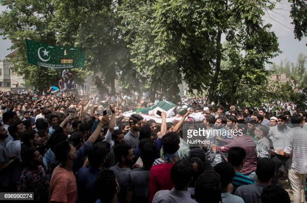 Kashmiris carry the body of local rebel Adil Ahmed during his funeral procession Saturday June 17 on the outskirts of Srinagar Indianadministered...