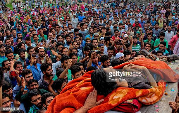 Kashmiris carry the body of Talib Hussain Shah who was killed in a gun battle between Indian government forces and him during his funeral on August...
