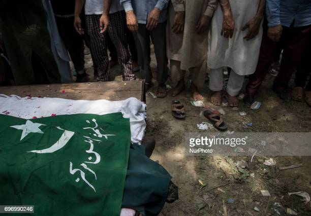 Kashmiris offer prayers during the funeral procession of local rebel Adil Ahmed Saturday June 17 on the outskirts of Srinagar Indianadministered...