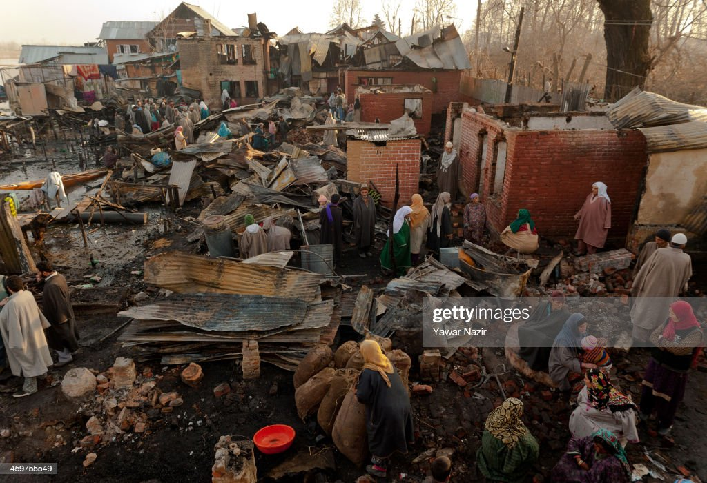 Kashmiris people salvage their belongings after a fire gutted many residential houses on December 30, 2012, in Srinagar, the summer capital of Indian administered Kashmir, India. Many families were left homeless amid sub-zero temperatures during the harshest 40-day period (Chilay Kalan) of the winter, after at least 30 residential houses were damaged in a devastating fire on the bank of famous Dal Lake near the Hazratbal shrine, in the outskirts of the Srinagar. The incident engulfed the area during the preceding night, an official said. No injuries were reported.