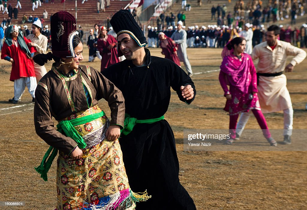 Kashmiris perform before main stream politicians and ministers during India's Republic Day celebrations on January 26, 2013 in Srinagar, the summer capital of Indian Administered Kashmir. All businesses, schools and shops were closed and traffic remained off the roads following a strike call given by Kashmiri separatist leaders against India's Republic Day celebrations in Kashmir. Meanwhile India deployed large numbers of Indian police and paramilitary forces to prevent any incidents during the official celebrations.