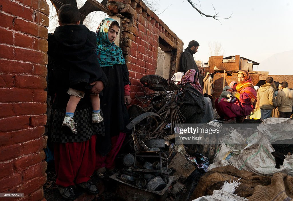 Kashmiris salvage their belongings after a fire gutted many residential houses on December 30, 2012, in Srinagar, the summer capital of Indian administered Kashmir, India. Many families were left homeless amid sub-zero temperatures during the harshest 40-day period (Chilay Kalan) of the winter, after at least 30 residential houses were damaged in a devastating fire on the bank of famous Dal Lake near the Hazratbal shrine, in the outskirts of the Srinagar. The incident engulfed the area during the preceding night, an official said. No injuries were reported.
