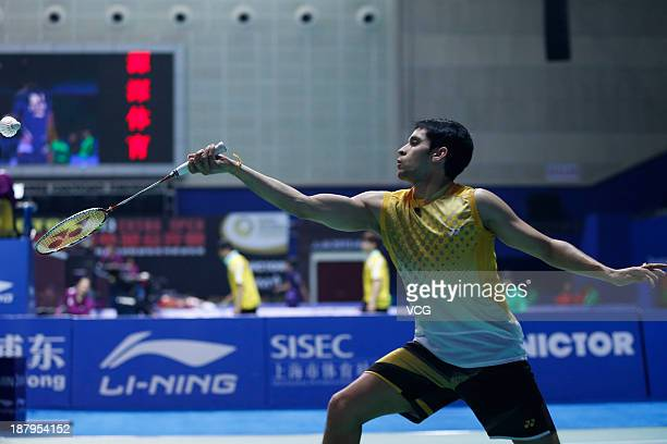 Kashyap Parupalli of India competes against Kento Momota of Japan during the men's singles match on day three of China Open 2013 at Yuanshen...