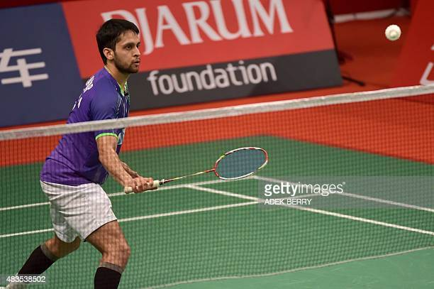Kashyap Parupalli of India eyes a return against Erik Meijs of the Netherlands during their men's singles qualifying match at the 2015 World...