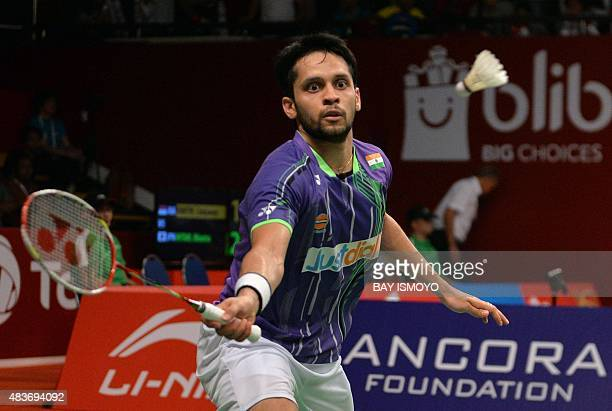 Kashyap Parupalli of India hits a return against Nguyen Tien Minh of Vietnam during their men's singles qualifying match at the 2015 World...