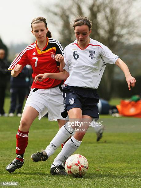 Kasia Lipka of England is tackled by Annabel Jager of Germany during the U15 Women's international friendly match between England and Germany at The...