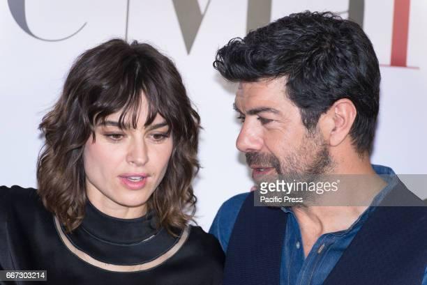Kasia Smutniak and Pierfrancesco Favino attend a photocall for 'Moglie E Marito'