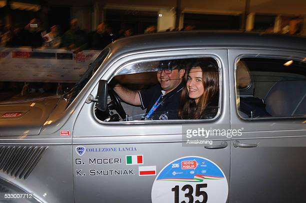 Kasia Smutniak passes through the city of Rimini on a 1939 Lancia Ardea during the first day of Mille Miglia on May 19 2016 in Rimini Italy