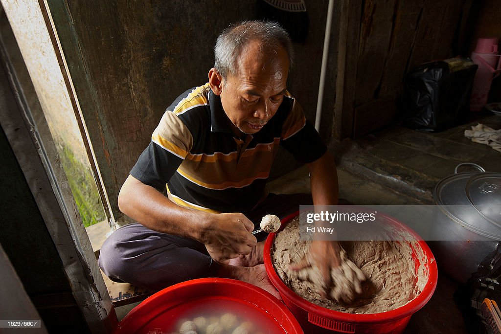 Kasidi, a seller of a popular meatball noodle soup called bakso, makes his meatballs in his kitchen on February 22, 2013 in Jakarta, Indonesia. The price of beef in Indonesia, now around Rp 95,000 (about USD 10) per kilo, has risen over the past 18 months due to strict import quotas for beef and live cattle which have also spawned a corruption scandal.