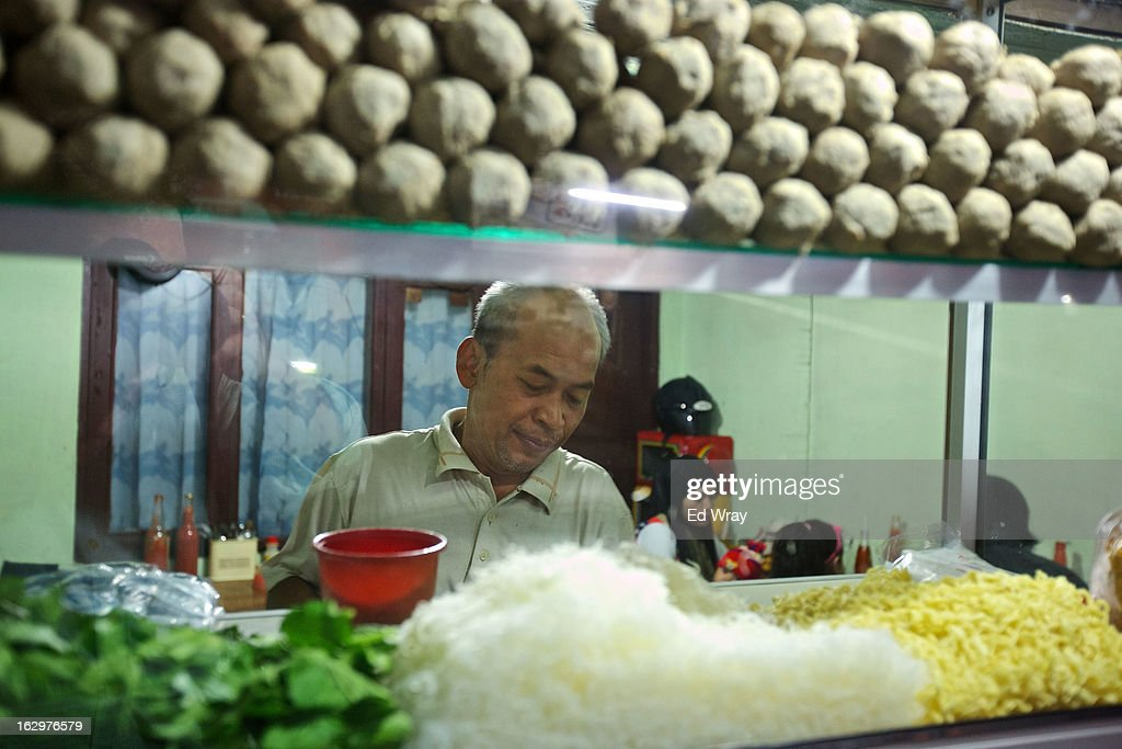 Kasidi, prepares his Bakso soup at his stall on February 24, 2013 in Jakarta, Indonesia. The price of beef in Indonesia, now around Rp 95,000 (about USD 10) per kilo, has risen over the past 18 months due to strict import quotas for beef and live cattle which have also spawned a corruption scandal.