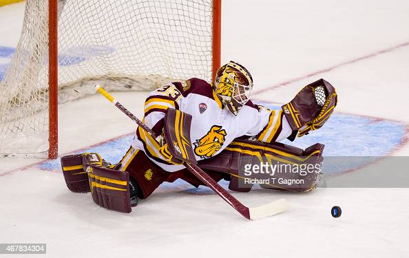 Kasimir Kaskisuo of the Minnesota Duluth Bulldogs makes a leg save against the Minnesota Golden Gophers during the NCAA Division I Men's Ice Hockey...