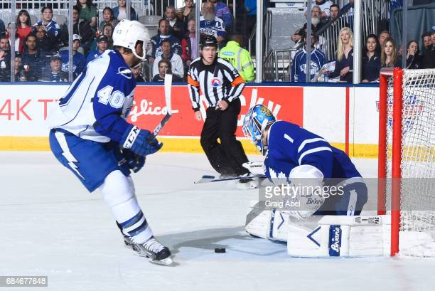 Kasimir Kaskisuo of the Toronto Marlies makes the save on Gabriel Dumont of the Syracuse Crunch during game 6 action in the Division Final of the...