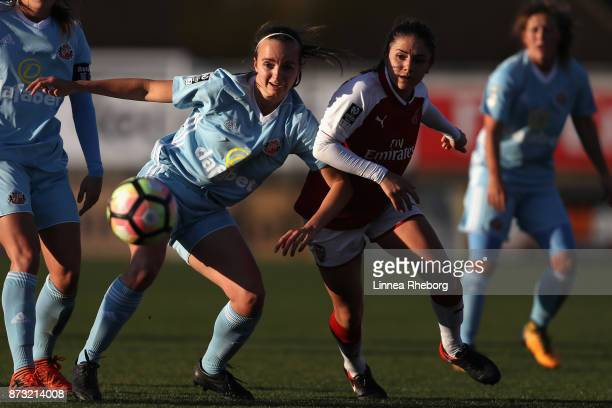 Kaskia Lipka of Sunderland AFC Ladies and Danielle Van de Donk of Arsenal battle for possession during the Women's Super League 1 match between...