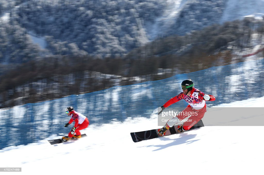 Kaspar Fluetsch of Switzerland (L) and <a gi-track='captionPersonalityLinkClicked' href=/galleries/search?phrase=Simon+Schoch&family=editorial&specificpeople=869279 ng-click='$event.stopPropagation()'>Simon Schoch</a> of Switzerland compete in the Snowboard Men's Parallel Giant Slalom 1/8 finals on day twelve of the 2014 Winter Olympics at Rosa Khutor Extreme Park on February 19, 2014 in Sochi, Russia.