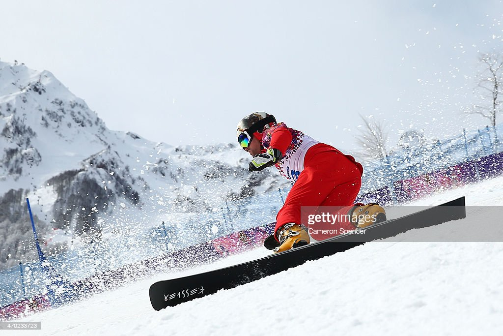 Kaspar Fluetsch of Switzerland competes in the Snowboard Men's Parallel Giant Slalom Qualification on day twelve of the 2014 Winter Olympics at Rosa Khutor Extreme Park on February 19, 2014 in Sochi, Russia.