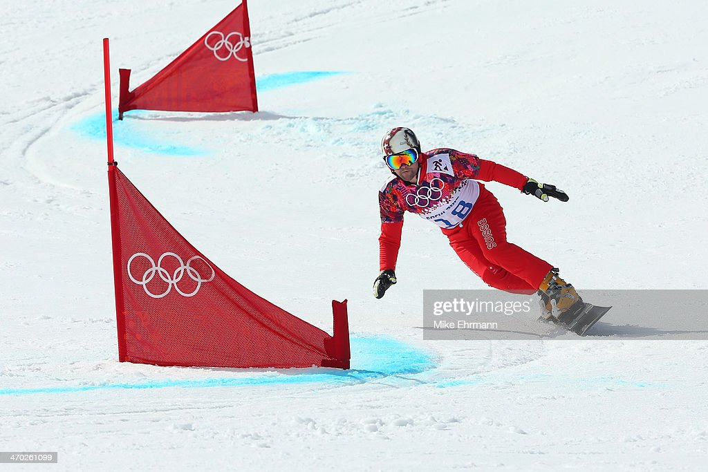 Kaspar Fluetsch of Switzerland competes in the Snowboard Men's Parallel Giant Slalom 1/8 Finals on day twelve of the 2014 Winter Olympics at Rosa Khutor Extreme Park on February 19, 2014 in Sochi, Russia.