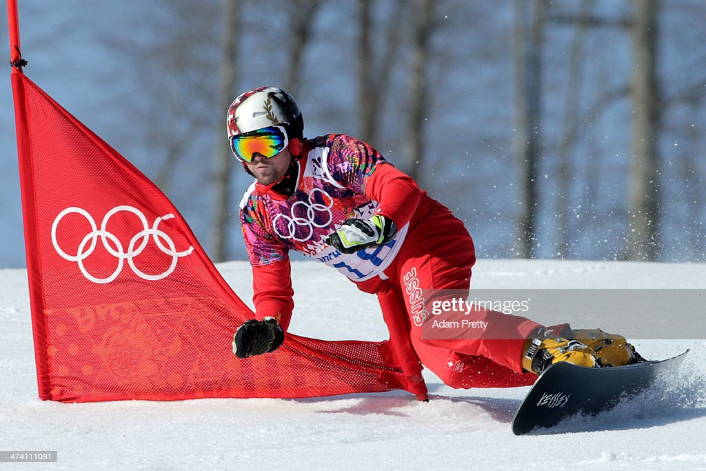 Kaspar Fluetsch of Switzerland competes in the Snowboard Men's Parallel Slalom Qualification on day 15 of the 2014 Winter Olympics at Rosa Khutor Extreme Park on February 22, 2014 in Sochi, Russia.
