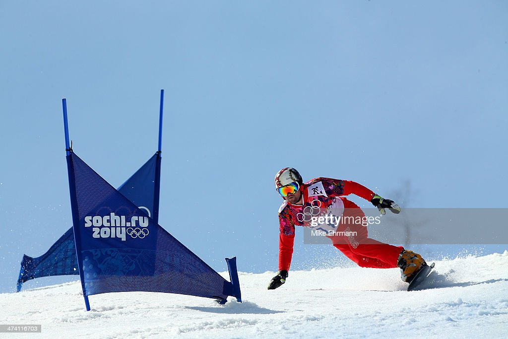 Kaspar Fluetsch of Switzerland competes in the Snowboard Men's Parallel Slalom 1/8 Finals on day 15 of the 2014 Winter Olympics at Rosa Khutor Extreme Park on February 22, 2014 in Sochi, Russia.