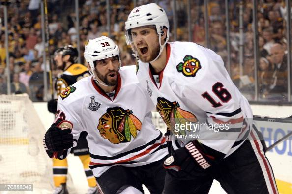 Kaspars Daugavins of the Boston Bruins celebrates with Michal Rozsival after scoring a goal in the second period against the Boston Bruins in Game...