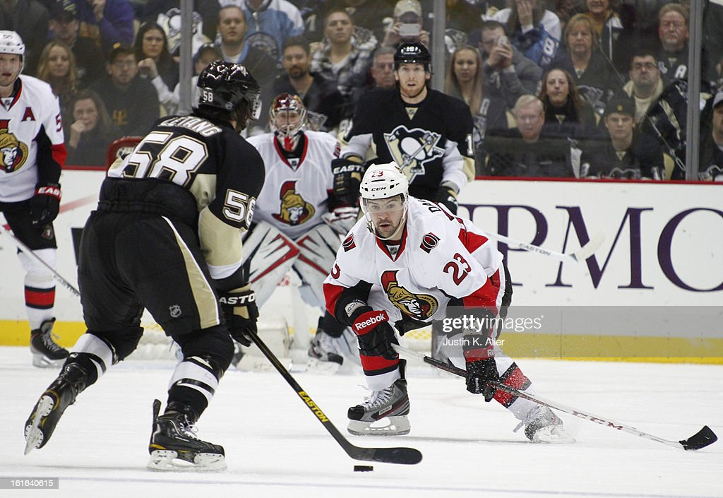 Kaspars Daugavins #23 of the Ottawa Senators eyes the puck during a Pittsburgh Penguins power play during the game at Consol Energy Center on February 13, 2013 in Pittsburgh, Pennsylvania. The Penguins won 4-2.