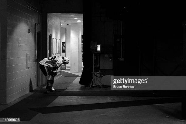 Kaspars Daugavins of the Ottawa Senators pauses outside the locker room as he gets set to play against the New York Rangers in Game One of the...