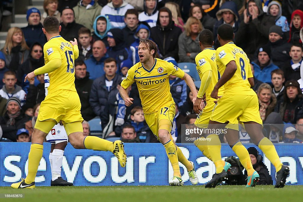 Kaspars Gorkss of Reading turns to celebrate the opening goal with team mates during the Barclays Premier League match between Queens Park Rangers and Reading at Loftus Road on November 4, 2012 in London, England.
