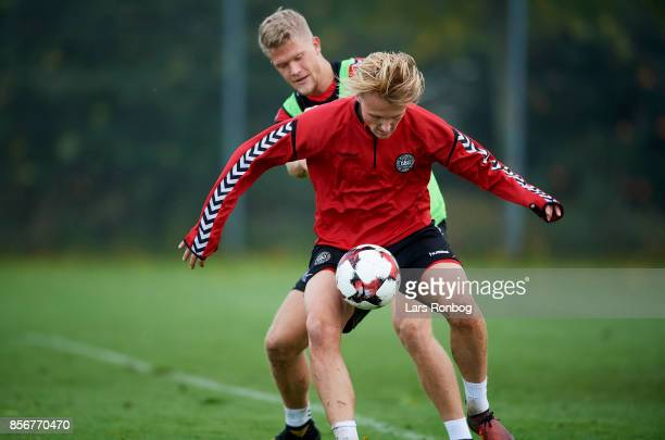 Kasper Dolberg and Andreas Cornelius compete for the ball during the Denmark training Session at Dragor Stadion on October 2 2017 in Dragor Denmark