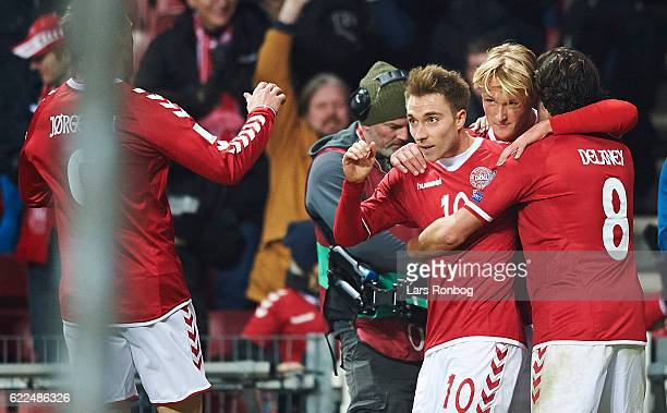 Kasper Dolberg Christian Eriksen and Thomas Delaney of Denmark celebrates after scoring their fourth goal during the FIFA 2018 World Cup Qualifier...