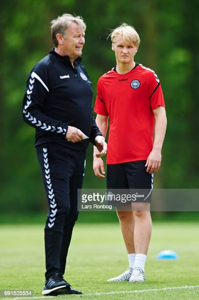 Kasper Dolberg listening to Age Hareide head coach of Denmark during the Denmark training session at Brondby Stadion on June 2 2017 in Brondby Denmark