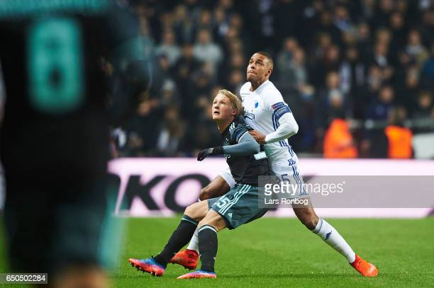 Kasper Dolberg of Ajax Amsterdam and Mathias Zanka Jorgensen of FC Copenhagen compete for the ball during the UEFA Europa League Round of 16 First...