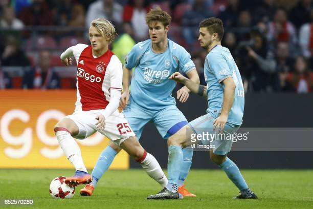 Kasper Dolberg of Ajax Amsterdam Joachim Andersen of FC Twente Mateusz Klich of FC Twenteduring the Dutch Eredivisie match between Ajax Amsterdam and...
