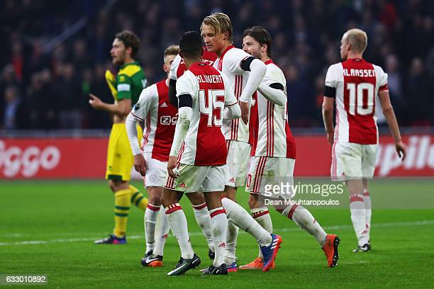 Kasper Dolberg of Ajax celebrates scoring his teams third goal of the game with team mates during the Eredivisie match between Ajax Amsterdam and ADO...