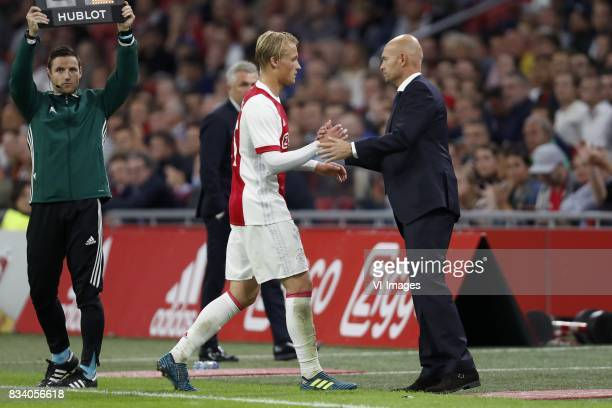 Kasper Dolberg of Ajax coach Marcel Keizer of Ajax during the UEFA Europa League fourth round qualifying first leg match between Ajax Amsterdam and...