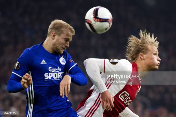 Kasper Dolberg of Ajax duels with Nicolai Boilesen FC Copenhagen during the UEFA Europa League Round of 16 second leg football match Ajax Amsterdam...