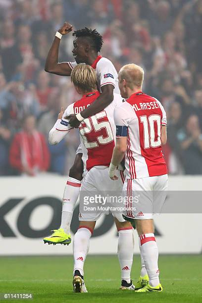 Kasper Dolberg of Ajax is congratulated by teammates Bertrand Traore and Davy Klaassen of Ajax after scoring the opening goal during the UEFA Europa...