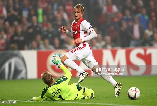 Kasper Dolberg of Ajax is tackled by goalkeeper JeanFrançois Gillet of Standard Liege during the UEFA Europa League group A match between Manchester...
