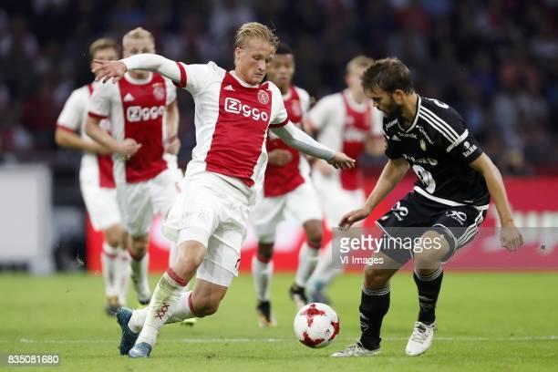 Kasper Dolberg of Ajax Jorgen Skjelvik of Rosenborg BK during the UEFA Europa League fourth round qualifying first leg match between Ajax Amsterdam...