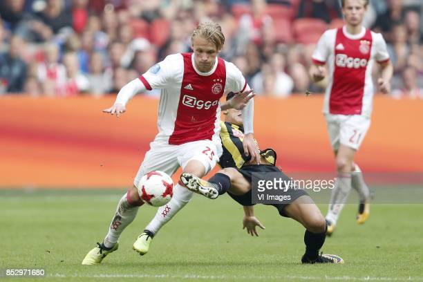 Kasper Dolberg of Ajax Navarone Foor of Vitesse during the Dutch Eredivisie match between Ajax Amsterdam and Vitesse Arnhem at the Amsterdam Arena on...
