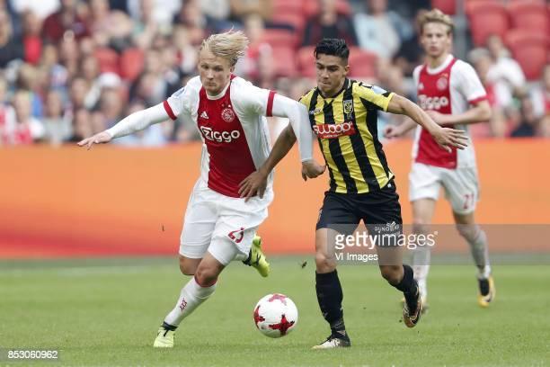 Kasper Dolberg of Ajax Navarone Foor of Vitesse Frenkie de Jong of Ajax during the Dutch Eredivisie match between Ajax Amsterdam and Vitesse Arnhem...