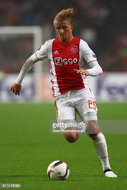 Kasper Dolberg of Ajax runs with the ball during the UEFA Europa League group G match between AFC Ajax and R Standard de Liege at the Amsterdam Arena...
