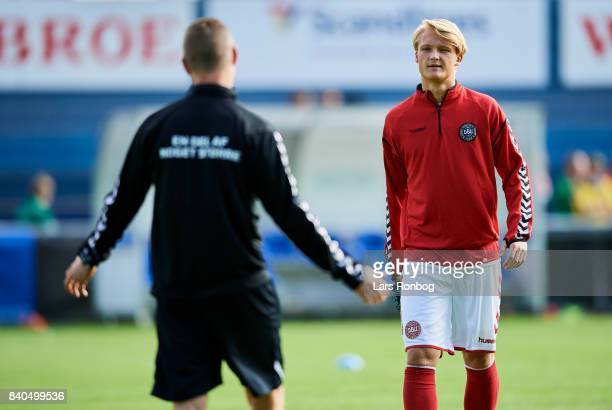 Kasper Dolberg speaks to Jon Dahl Tomasson assistant coach of Denmark during the Denmark training session at Helsingor Stadion on August 29 2017 in...