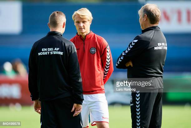 Kasper Dolberg speaks to Jon Dahl Tomasson assistant coach of Denmark and Age Hareide head coach of Denmark during the Denmark training session at...