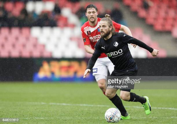Kasper Fisker of Randers FC and Andreas Albers of Silkeborg compete for the ball during the Danish Alka Superliga match between Silkeborg IF and...