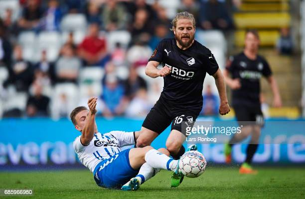 Kasper Fisker of Randers FC and Casper Nielsen of OB Odense compete for the ball during the Danish Alka Superliga match between OB Odense and Randers...