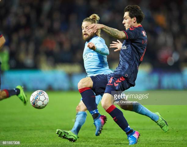 Kasper Fisker of Randers FC and Daniel A Pedersen of AGF Arhus compete for the ball during the Danish Alka Superliga match between Randers FC and AGF...
