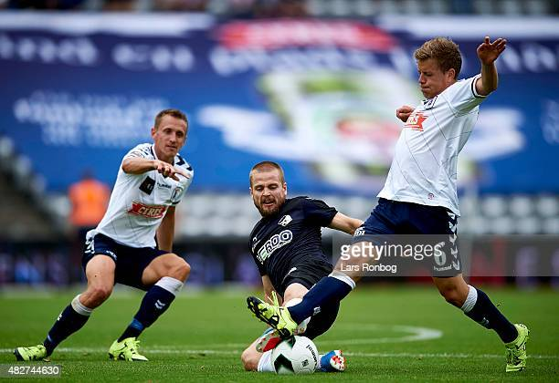 Kasper Fisker of Randers FC and Daniel Christensen of AGF Aarhus compete for the ball during the Danish Alka Superliga match between AGF Aarhus and...