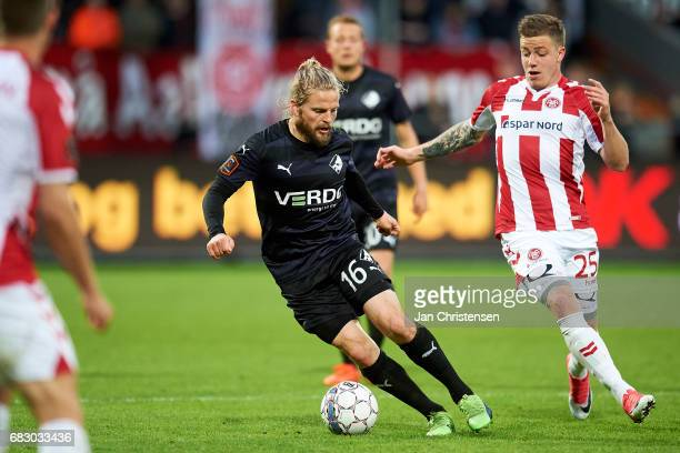 Kasper Fisker of Randers FC and Frederik Borsting of AaB Aalborg compete for the ball during he Danish Alka Superliga match between AaB Aalborg and...