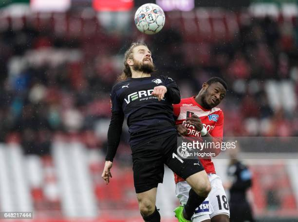 Kasper Fisker of Randers FC and Ibrahim Moro of Silkeborg compete for the ball during the Danish Alka Superliga match between Silkeborg IF and...