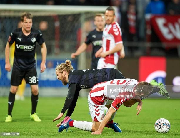 Kasper Fisker of Randers FC and Jakob Ahlmann of AaB Aalborg compete for the ball during the Danish Alka Superliga match between AaB Aalborg and...